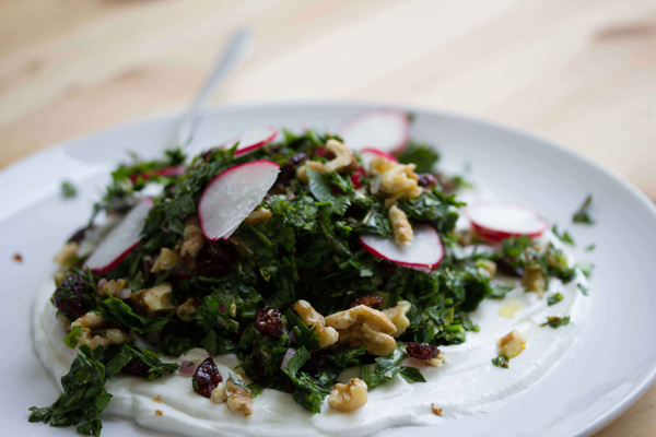Herb Salad with Pomegranate Dressing over Labaneh!
