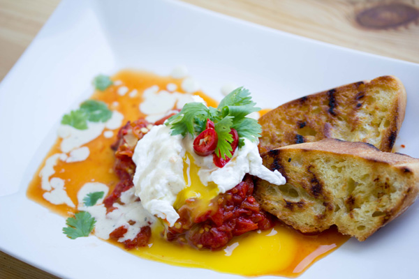 Roasted pepper shakshuka with poached egg and tahini drizzle