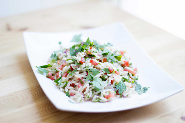 A twist on the traditional tabouli salad recipe, using orzo instead of bulgur!