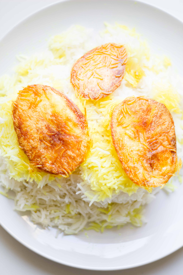 This divine Persian rice recipe shows you how to make the fluffiest rice side dish with crispy potatoes! | www.seriousspice.com