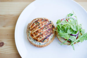 Mozzarella stuffed salmon burgers with tangy garlic aioli make for a unique summer recipe that you'll be sure to impress with!