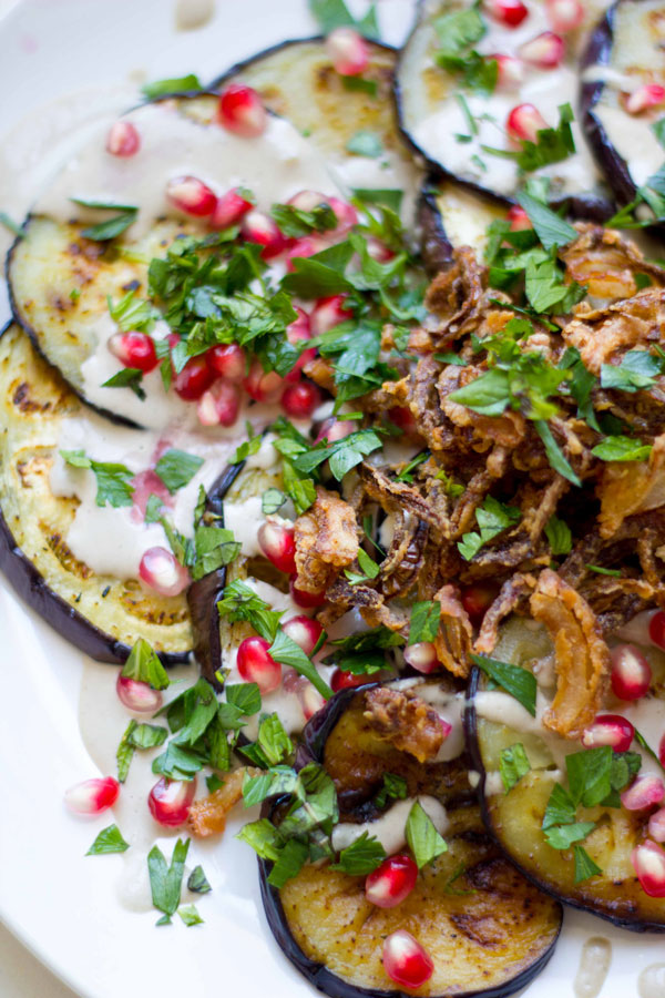 This eggplant with pomegranate tahini and crispy fried onions makes for the perfect Rosh Hashanah appetizer!